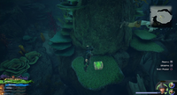 The High Seas / Sandbar Isle: On the island, on the side of the pillar in the center of the pool of water.